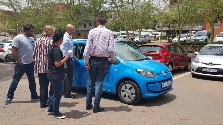 Everyone at the office, huddling around the baby VW